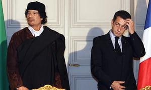 Libya leader Col. Muammar Gaddafi along with former French President Nicolas Sarkozy