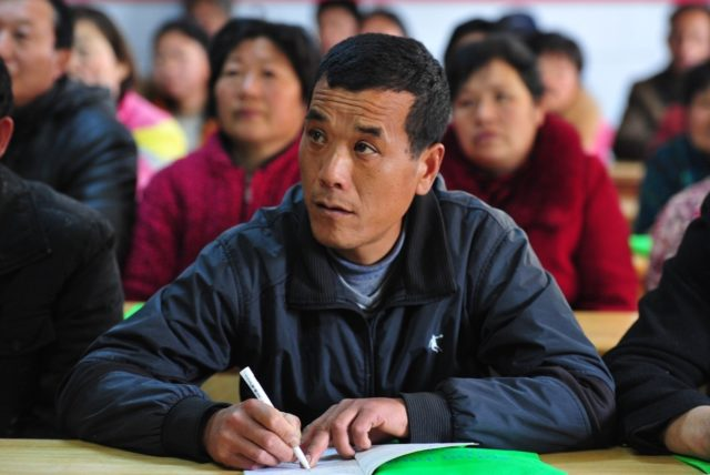 Poverty-stricken residents at Chenxiaozhai village, Anqing, central China's Anhui province, attended lesson to learn skills, April 12, 2017. China hits a record of lifting over 68 million people out of poverty in the past five years. (Photo from CFP)