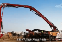 "Pump truck with a 47-meter-long arm. (Source: screenshot from the documentary ""The Pillars of a Great Power II"" filmed by China Central Television.)"