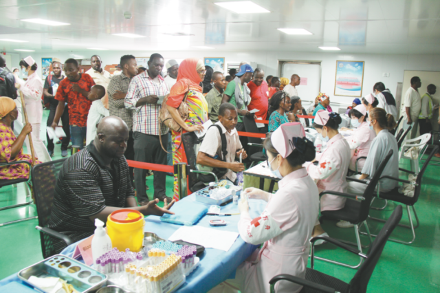 Tanzanian people receive medical examinations on Peace Ark, Nov. 20, 2017. (Photo by Li Zhiwei from People's Daily)