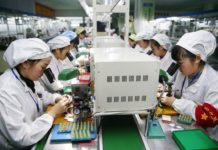 Workers assemble micro and special motors used in phones at a manufacturer in Huaibei, Anhui province, Dec. 8, 2017. Up to now, the annual production capacity in this city has reached 250 million, accounting for one fifth of the global market, and the self-developed micro motors have been used in phones of Microsoft, Samsung, Apple, Huawei, Xiaomi and other famous brands. The micro motors, which have been granted with over 100 patents, are often in short supply. (Photo from CFP)
