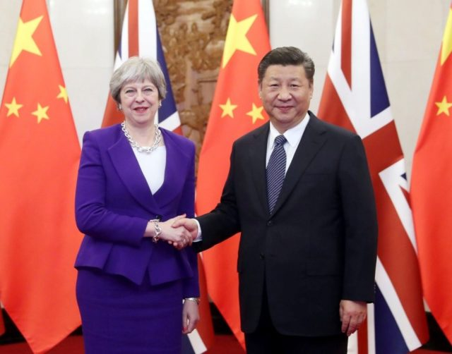 Chinese President Xi Jinping (R) meets with visiting British Prime Minister Theresa May in Beijing, capital of China, Feb. 1, 2018. (Xinhua/Liu Weibing)