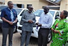 Dr. Nicholas Kanlisi, Rep of Columbia University (second from right) hands over keys of the seven cars to Dr. Anthony Nsiah-Asare, Director General (DG) of Ghana Health Service (third from right). Looking on are Dr. Gloria Quansah, Deputy DG and Dr. Koku Awoonor Director PPME