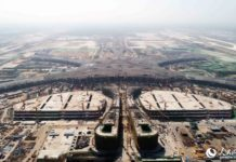 The terminal of the new airport is being constructed. (Photo by Lei Sheng from People's Daily)