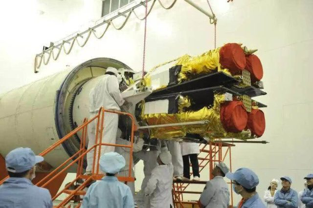 A satellite is loaded onto the Long March-11 rocket. (Photo from official website of China Academy of Launch Vehicle Technology)