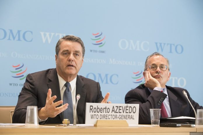 The World Trade Organization (WTO) Director-General Roberto Azevedo (L) addresses a press conference in Geneva, Switzerland, April 13, 2018. The World Trade Organization (WTO) said on Thursday that the global trade is expected to remain strong, with the merchandise trade volume growing 4.4 percent in 2018 and 4.0 percent in 2019. (Xinhua/Xu Jinquan) (srb)