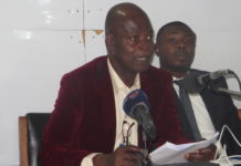 Dr Steve Manteaw addressing the press