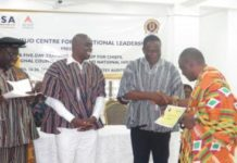 Mr Kofi Dzamesi (2nd R) presenting a certificate to Togbe Gabusu (1st R), the Paramount Chief of Gbi Traditional Area, looking on are Professor Abednego Feehi Okoe Amartey (3rd R) and Lepowura Alhaji Mohammed Nurudeen Dramani Jawula (4th R).