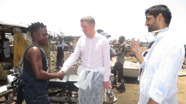 Mr Iain Walker (middle) interacting with an artisan