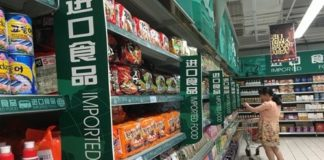A consumer shops for imported products in a supermarket in Beijing. File photo: VCG
