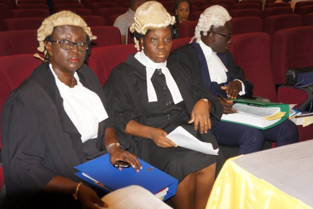 State Counsel listens attentively