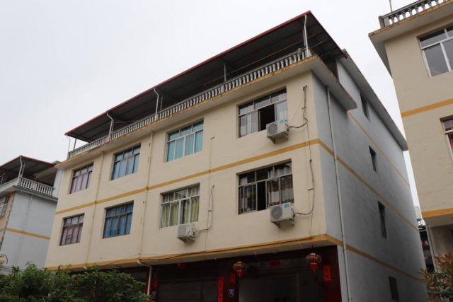 Photo shows Liu Deren's three-storey house. Like Liu, most villagers have moved into such houses. Photo by Liu Lingling
