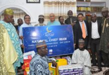 QNET officals donating food items and cash to Chief Imam