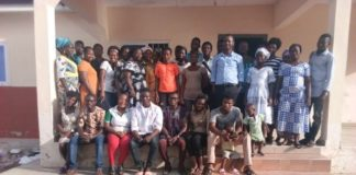 A group photo of the youth and the media practitioners and some staff of WOM