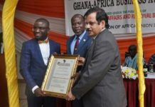 Mr. David Adikah, Head of Marketing and Mr. V. S. Reddy, Head of Finance (Left) receiving the award on behalf of Avnash Industries Ghana Limited from Habibu Tijani, Deputy Minister of Foreign Affairs (middle)