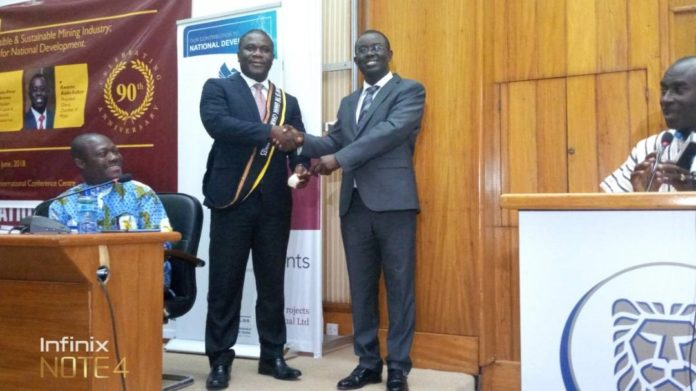 Mr. Kwame Addo-Kufour (R), the former President of the GCM handing over to Mr. Eric Asubonteng, the current President of the Chamber at its 90th AGM held in Accra