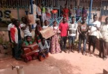Photo of the beneficiaries with their respective parents holding their tool kits