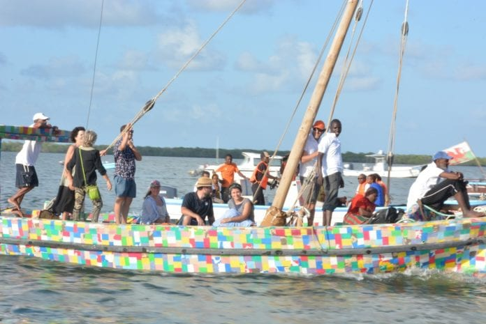 Revelers ride in a newly launched world first 100% recycled plastic sail boat in Lamu County, Kenya, Sept. 15, 2018. The nine-metre sailing dhow made from over 10 tonnes of collected plastic waste is aimed at raising awareness of the dangers of the single use culture that leads to plastic being dumped in the sea. (Xinhua/Charles Onyango)