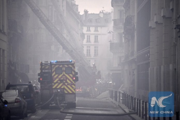 Firefighters work at a blast site amid smoke and dust in Paris, France, Jan. 12, 2019. A huge gas explosion in central Paris injured at least 20 people on Saturday, of whom two were in critical condition, Le Figaro newspaper reported. The explosion occurred at around 9 a.m. (0800 GMT) in a closed bakery on the Rue de Trevise in the 9th district of Paris due to a suspected gas leak. (Xinhua/Chen Yichen)