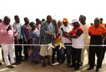 Mr Patrick Akpe Kwame Akorli Group CEO of GOIL, assisted by the Brand Ambassador, Barimah Zoom Zoom Azumah Nelson, and other Officials cut the tape to open the station.