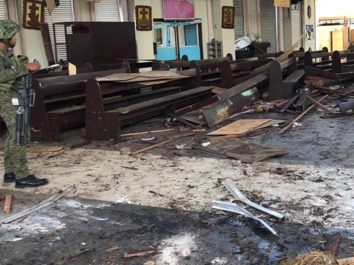 A soldier guards the explosion scene inside a church in Sulu Province, the Philippines, Jan. 27, 2019. The death toll climbed to 27 in the twin explosions at a church in the Sulu province of the southern Philippines, the police said. (Xinhua)