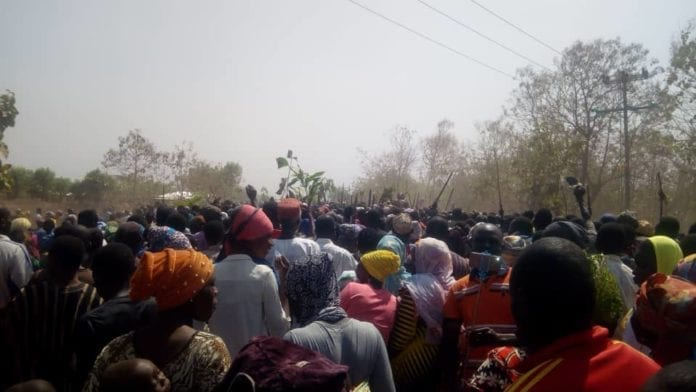 Scores of people cheering on the chief to Tamale