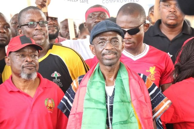 General Secretary of the NDC, Asiedu Nketia [with the Ghana flag around his neck]