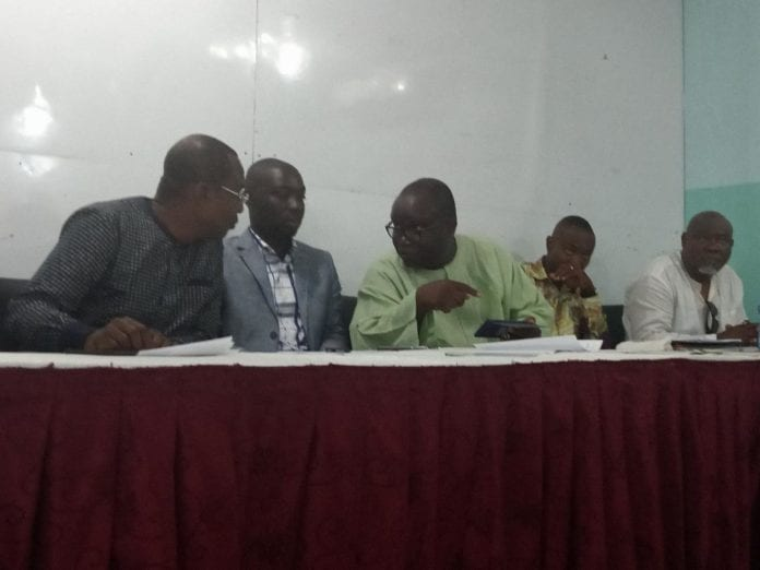 Mr Ken Ashigbey (middle) interacting with Affail Monney (first left)
