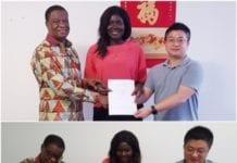 Dr. Kludjeson, Roberta Annan and CEIEC representative sign the MOU