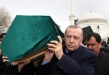 Turkey's President Recep Tayyip Erdogan carries a coffin as he joins hundreds of mourners who attend the funeral prayers for nine members of Alemdar family killed in a collapsed apartment building in Istanbul. AP