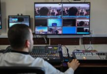 A journalist at work inside Al-Aqsa TV studio in Gaza City (Mohammed A. Alhajjar/MEE)