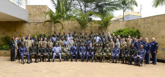 Participants in the African Partnership Flight Rwanda pose for a group photo in Kigali, Rwanda, March 4, 2019. Hosted by the Rwanda Defence Force and U.S. Air Forces Africa, APF Rwanda's focus is on sharing best practices for flight, ground, and weapon safety. APF Rwanda participants include military representatives from Rwanda, the United States, Cameroon, Ghana, Senegal, and Zambia. (U.S. Air Force photo by Tech. Sgt. Timothy Moore)
