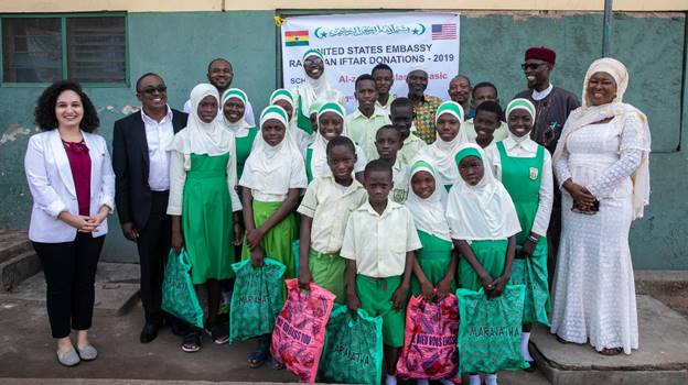 U.S. Embassy representatives pose for a group photograph with some pupils and teachers of the Al-Zakiyya Islamic Basic School, Abeka Lapaz after a presentation of food items to the school.
