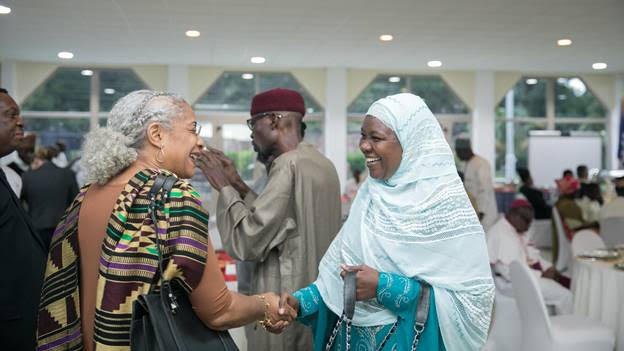 U.S. Agency for International Development – Ghana Mission Director Sharon Cromer, in a warm hand-shake with the President of the Zakat Fund, Mrs. Azara Abubakari-Harou,.