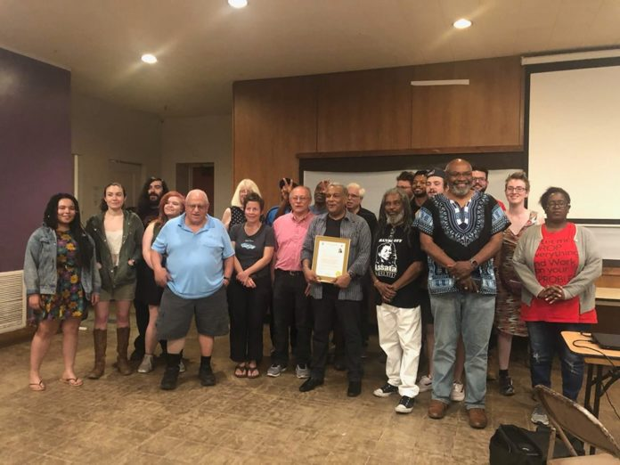Abayomi Azikiwe with Moratorium NOW! Coalition members and supporters at the Cuba Caravan public meeting featuring Dr. Luis Barrios, June 19, 2019