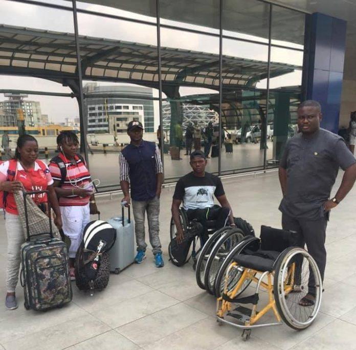 Wheelchair Tennis players and a Coach