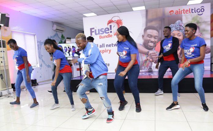Dancegod Lloyd performing the Fuse song dance with AirtelTigo staff-1