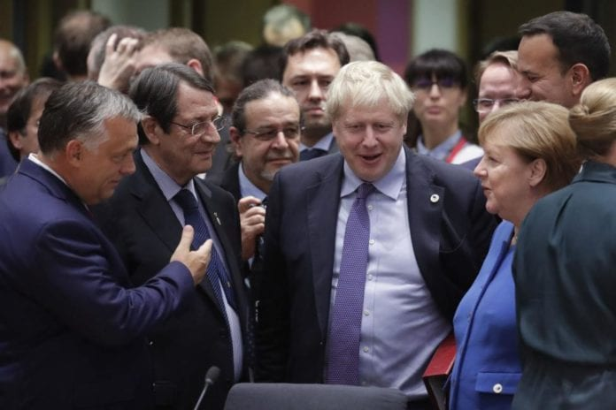 British Prime Minister Boris Johnson speaks to foreign leaders at a Brexit summit in Brussels, Belgium, on October 17. Photo by Olivier Hoslet/EPA-EFE