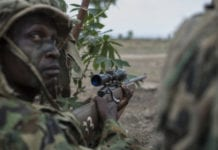 TOPSHOT - A member of the Nigerian Armed Forces Sniper Unit wearing a ghillie suit takes part in an exercise during the African Land Forces Summit (ALFS) military demonstration held at General Ao Azazi barracks in Gwagwalada on April 17, 2018. - The African Land Forces Summit (ALFS) is a weeklong seminar held in Nigeria, bringing together land forces from across Africa to discuss and develop cooperative solutions and improve transregional security and stability. (Photo by STEFAN HEUNIS / AFP) (Photo credit should read STEFAN HEUNIS/AFP/Getty Images)