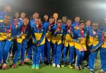 Players and officials of Royal Ladies displaying their medals after the tournament