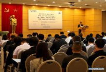 People participate in a seminar about trade and investment cooperation between China and Vietnam, in Hanoi, Vietnam, on Nov. 18, 2019. The seminar attracted nearly 100 officials and entrepreneurs to study potentials of the Vietnamese market and seek cooperation opportunities. (Xinhua/Wang Di)