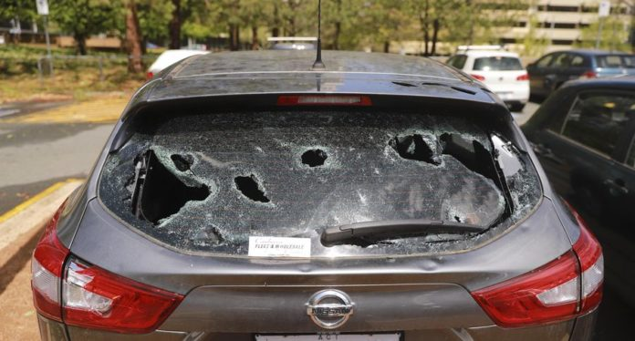 Photo taken on Jan. 20, 2020 shows serious vehicle damages caused by huge hailstones in Canberra, Australia. (Photo by Liu Changchang/Xinhua)