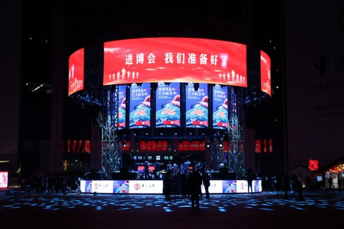 """On the central plaza stage of the National Exhibition and Convention Center(Shanghai), the LED screen displays """"the Expo, we are ready!"""" (Photo by Qu Song from People's Daily)"""