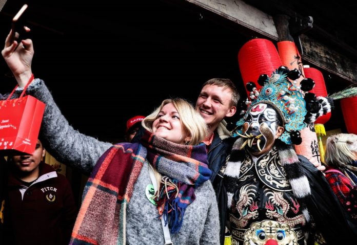 More than 100 foreign guests from 30 countries including Russia, India and Morocco experience local traditional folk customs to greet the Spring Festival in Qiantong ancient town in Ninghai county, Ningbo city of east China's Zhejiang province on Jan.11, 2020. The activity serves as a platform for cultural exchanges between China and foreign countries. It allows foreign friends to feel the glamour of Chinese culture and promotes their understanding of Chinese culture. Photo by Zhang Yongtao from People's Daily Online