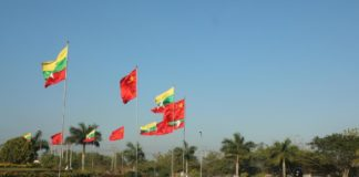 The national flags of China and Myanmar fly high in the street of Myanmar before Chinese President Xi Jinping's visit to Myanmar. Photo by Sun Guangyong from People's Daily