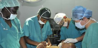 Zhang Xuehui (2nd R) and Deng Qiaorong (1st R), members of a Chinese medical team, prepare an operation for a hydrocephalic child in Asmara, Eritrea, May 23, 2008. (Xinhua/Zhu Xiaoguang)