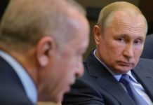 Russian President Vladimir Putin (R) listens to Turkish President Recep Tayyip Erdogan during their meeting in Sochi, Russia, on Oct. 22, 2019. Russia and Turkey have adopted a joint memorandum on the situation in Syria after the talks between Russian President Vladimir Putin and his Turkish counterpart Recep Tayyip Erdogan in Sochi. According to the memorandum, Moscow and Ankara have agreed to deploy Russian and Syrian forces in zone of the Turkish operation in Syria starting from Wednesday. (Sputnik via Xinhua)