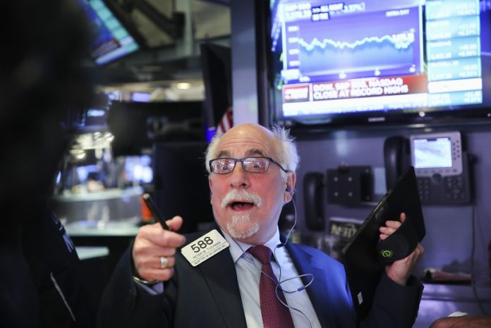 A trader works at the New York Stock Exchange in New York, the United States, on Nov. 4, 2019. U.S. stocks ended higher on Monday. The Dow Jones Industrial Average rose 114.75 points, or 0.42 percent, to 27,462.11. The S&P 500 rallied 11.36 points, or 0.37 percent, to 3,078.27. The Nasdaq Composite Index was up 46.80 points, or 0.56 percent, to 8,433.20. (Xinhua/Wang Ying)