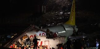 Rescuers work beside the plane that skidded off the runway at Istanbul's Sabiha Gokcen International Airport, Turkey, on Feb. 5, 2020. At least 120 people were wounded when a plane slided off the runway at Istanbul's Sabiha Gokcen International Airport on Wednesday, Istanbul governor Ali Yerlikaya told reporters. (Xinhua/Xu Suhui)