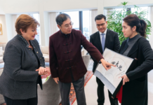 "IMF China Executive Director Jin Zhongxia thanked Giorgieva's support for China during the coronavirus outbreak and presented her with calligraphy artwork that read, ""Spring comes back to Earth."" (Photo: IMF)"